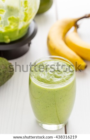 Absolutely Amazing Tasty Green Avocado Shake, Made with Fresh Avocados, Banana, Lemon Juice and Non Dairy Milk (Almond, Coconut) on Light White Wooden Background, Raw, Vegan Drink Conception, Close-up - stock photo