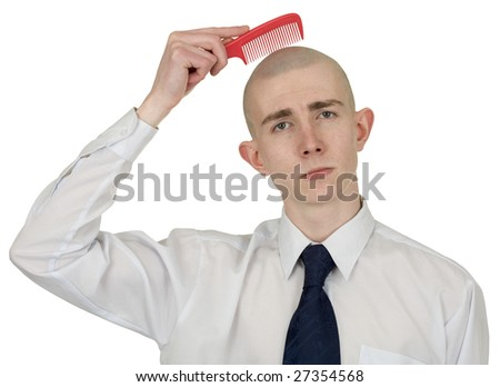 Absolutely bald guy with a hairbrush in a hand - stock photo