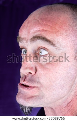 Absolutely shocked and outraged guy, studio shot - stock photo
