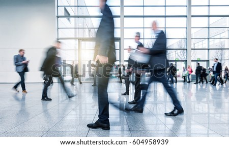 abstakt image of blurred Business people walking