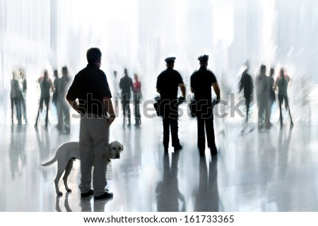 abstakt image of people and security guard with a dog in the lobby of a modern business center with a blurred background - stock photo