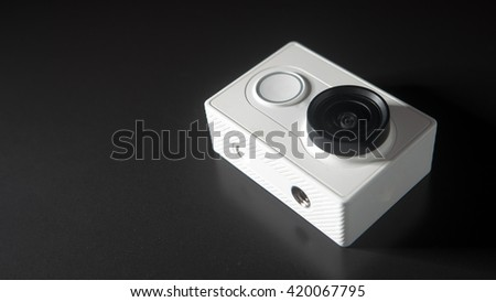 Abstract action camera on black background, unrecognizable brand model, copy-space - stock photo
