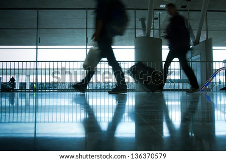 abstract airport and silhouette of people walking with luggage, commuter - stock photo