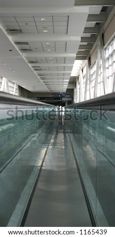 Abstract airport people mover - stock photo