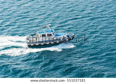 Abstract and conceptual help. A pilot boat in sea. A pilot boat is a type of boat used to transport maritime pilots between land and the inbound or outbound ships that they are piloting.