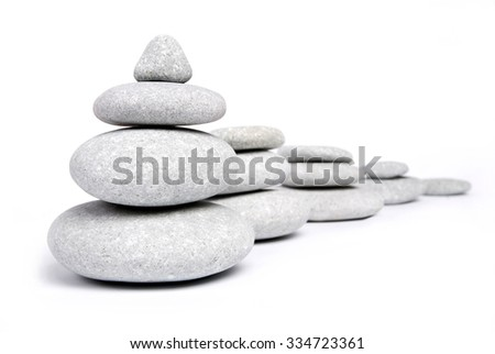 Abstract and Objects. Stone towers isolated on white - stock photo