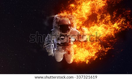 Abstract apocalyptic background - burning Astronaut. Elements of this image furnished by NASA - stock photo