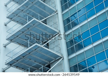 Abstract architectural Building exterior of steel staircase and modern glass window - Color tone effect - stock photo