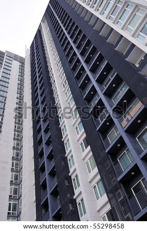 Abstract Architectural Detail of a High Rise Apartment Block - stock photo