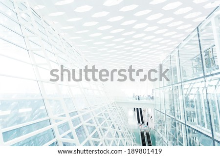 Abstract architectural wall of glass and steel in modern office - stock photo