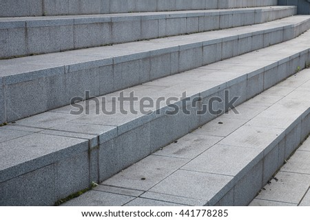 Abstract architecture fragment. stairway made of gray granite stone blocks, closeup photo - stock photo