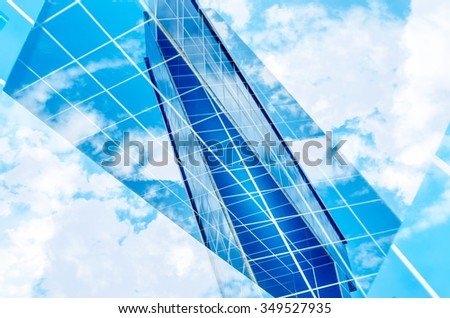 abstract architecture in front of cloudy blue sky double exposure - stock photo
