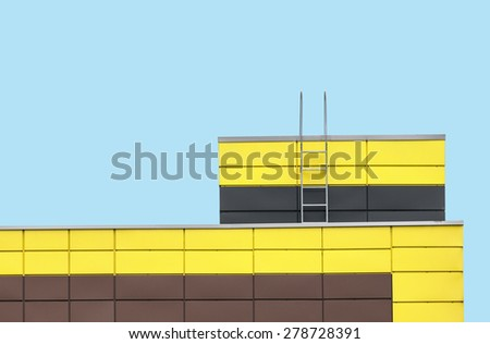 Abstract architecture picture. Multicolored building facade on flat cyan color background - stock photo