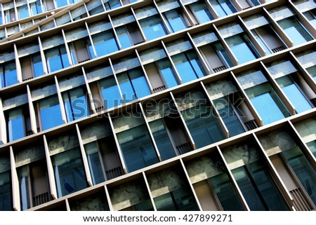 Abstract architecture shot of business or commercial glass and steel building - stock photo