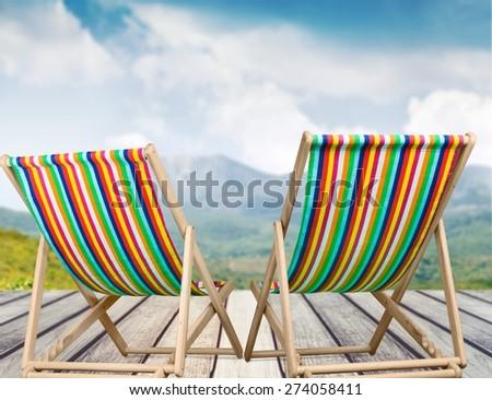 Abstract, armchair, beach. - stock photo