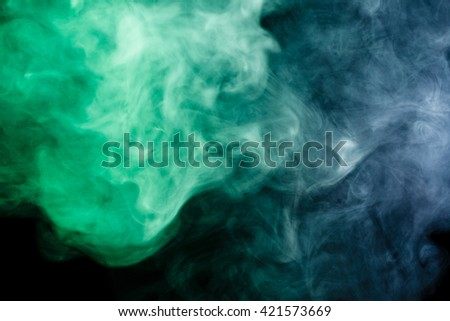 Abstract art. Blue-green smoke hookah on a black background. Inhalation. The steam generator. The concept of poison gas. Gas. - stock photo