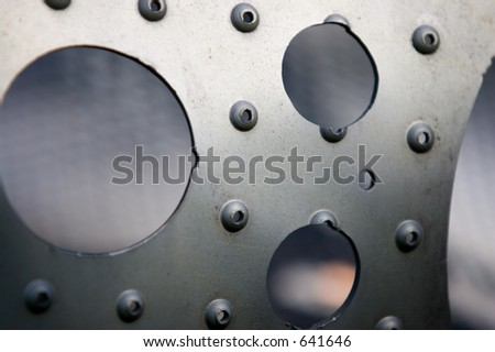 Abstract Art: Circles of Cold Hard Metal.  Great perspective of cold hard metal