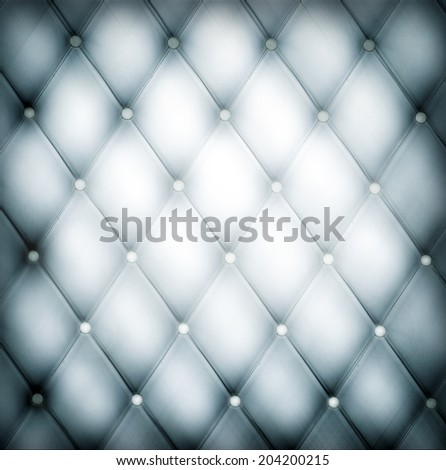 Abstract art used skin background texture of old natural luxury modern style rhombs leather. Classic light blue and dark gray grungy decor retro wall, door, sofa, studio interior with metal buttons. - stock photo
