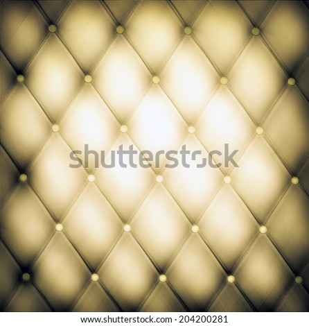 Abstract art used skin background texture of old natural luxury modern style rhombs leather. Classic light gray and dark yellow grungy decor retro wall, door, sofa, studio interior with metal buttons. - stock photo
