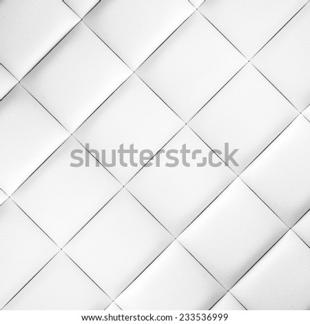Abstract artistic background texture of an old natural luxury modern style leather with rhombs Classic light snowy white, dark gray grungy skin of retro wall, door, sofa, studio interior with buttons - stock photo