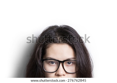 Abstract Asian woman wearing glasses looking to camera isolated on white background. - stock photo