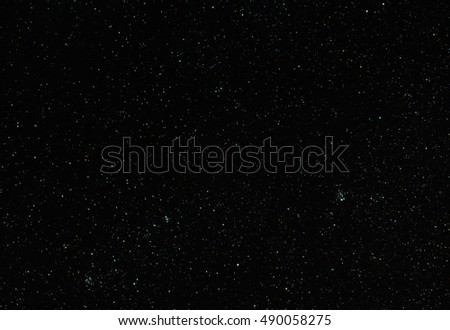 Abstract astronomy space universe background: black night sky with stars. Can be used as a wallpaper or backdrop.