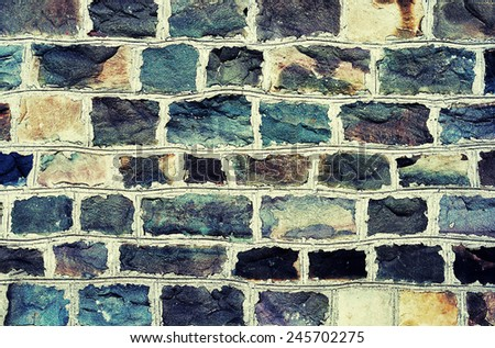 abstract background -  ancient wall close up, cross-processing effect - stock photo