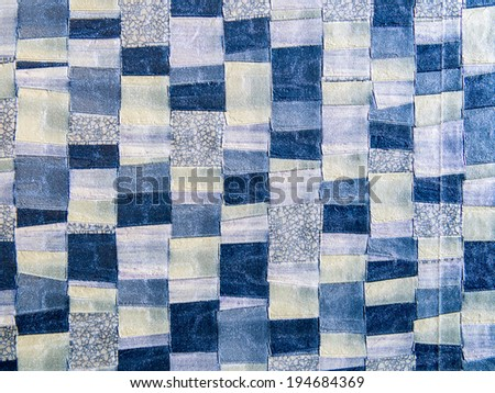 Abstract background and textured of jeans fabric collage wall covering pattern