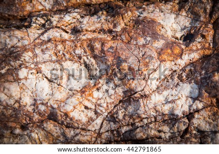 Abstract background as a solid stone wall - stock photo