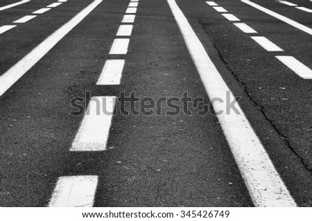 abstract background - asphalt road with road marking close up - stock photo