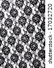abstract background black fabric with flowers - stock photo