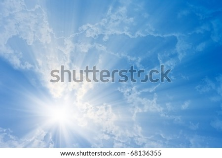 Abstract background - bright sun in blue sky - stock photo