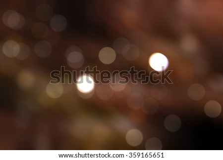 abstract background brown bokeh circles. Beautiful background with particles. - stock photo