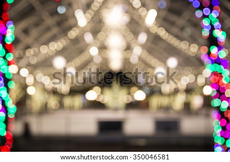 Abstract background christmas lights of ice skating ring - stock photo