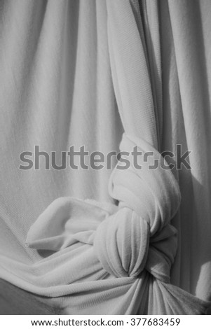 abstract background cloth or liquid wave or wavy folds of grunge silk texture material or luxurious