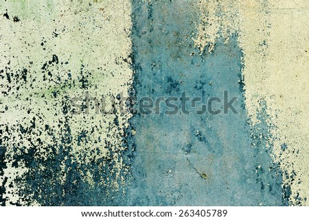 Abstract background concrete painted yellow and green paint, weathered with cracks and scratches. Landscape style. Grungy Concrete Surface. Great background or texture. - stock photo