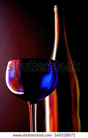 Abstract background design made from an empty wine glass and bottle.