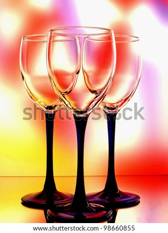 Abstract  background design of wine glassware on multicolored   background