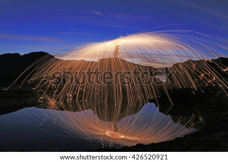 Abstract background fire painting. light painting with sparks. - stock photo