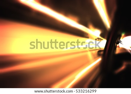 Abstract background from blurred moving car light in tunnel