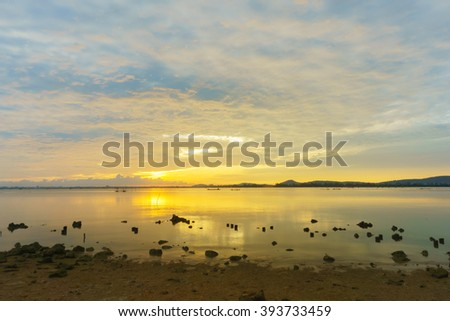 Abstract background from colorful sky reflex with sunrise at lake in the morning:Ideal use for background:Unfocused image.
