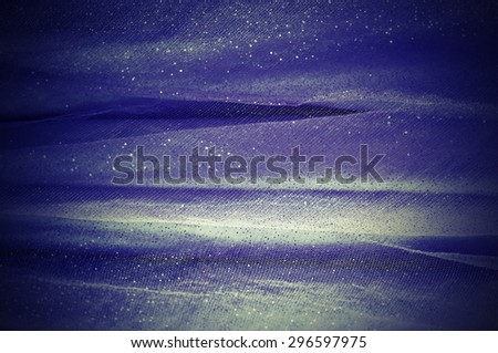 Abstract background from dark blue delicate fabric - stock photo