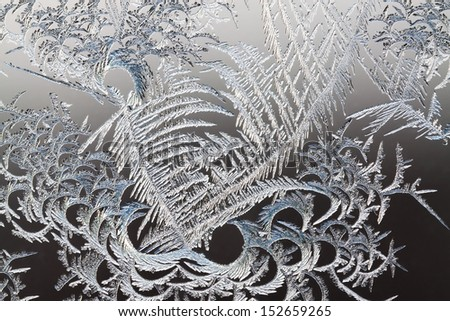 abstract background from frosty pattern on glass - stock photo