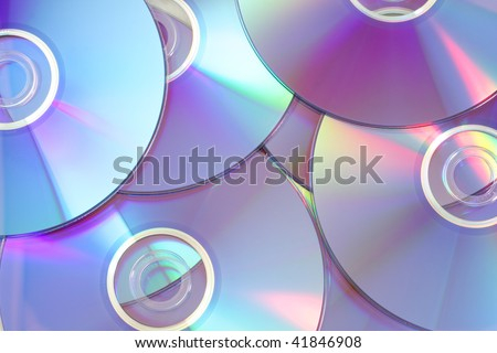 Abstract background from several colored DVD disks - stock photo
