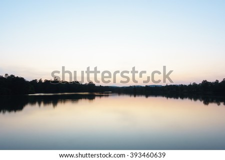 Abstract background from silhouette un focus image view of colorful sky reflex water in evening :ideal use for background.