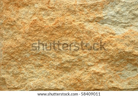 Abstract background from yellow stone wall - stock photo