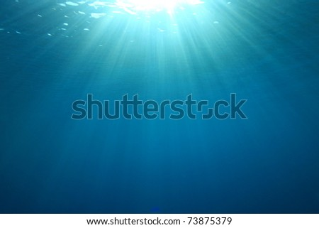 Abstract background image of Sunburst on the Ocean Surface - stock photo