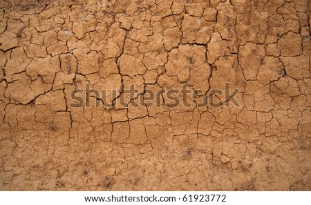 Abstract background in the form of the cracked clay wall - stock photo