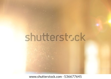 Abstract background - light flashes and bokeh. Sun rays. Shadows. Lens flare.