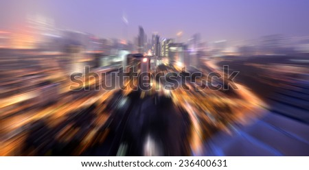 abstract background lights of building in the city with motion blur effect - stock photo